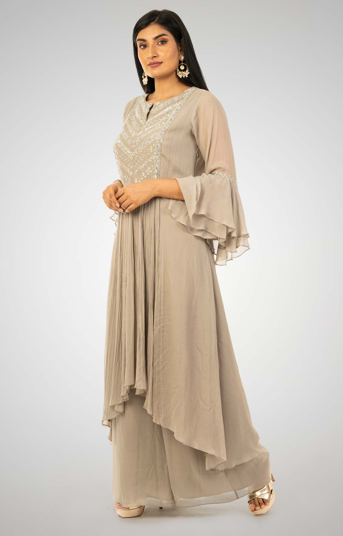 Glided Beige Crepe Palazzo Suit With A-Symmetrical A-line Kurta Adorned With Moti And Bead Work – Viraaya By Ushnakmals