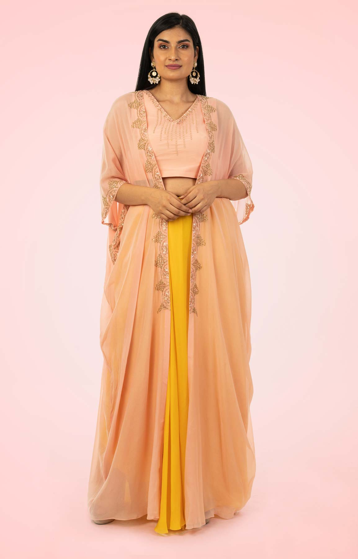Mustard Draped Skirt Paired With Hand Embroidered Peach Crop Top And Kaftan Style Jacket – Viraaya By Ushnakmals